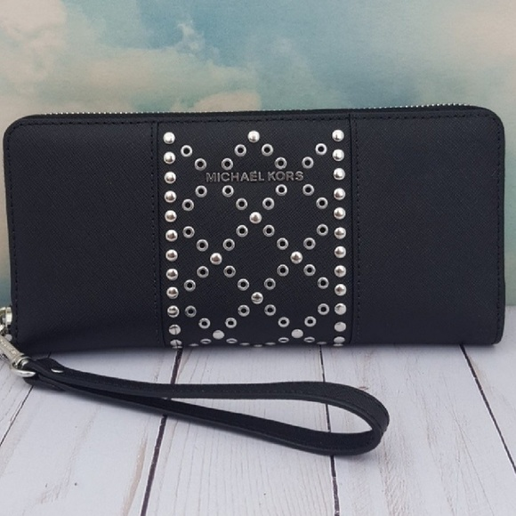 56826703409f19 Michael Kors Black Leather Studded Wallet Wristlet.  M_5b08833d3b160885dfb628cf
